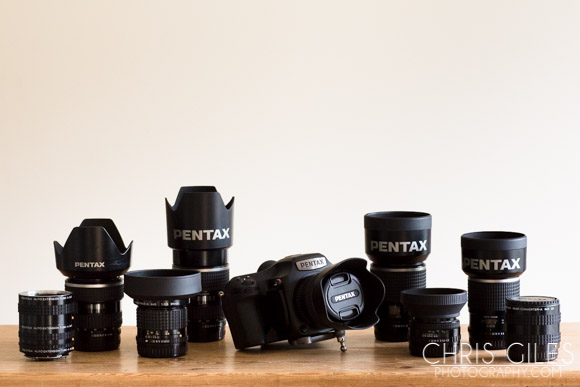 A Pentax 645z overview. From left, Extension tube set, the 45-85mm FA 4.5, the 35mm A, the 80-160mm FA, the Pentax 645z and 55mm D-FA 2.8, the 120mm F4 Macro, the 75mm 2.8 FA, 150mm 2.8 FA and finally the x2 extender