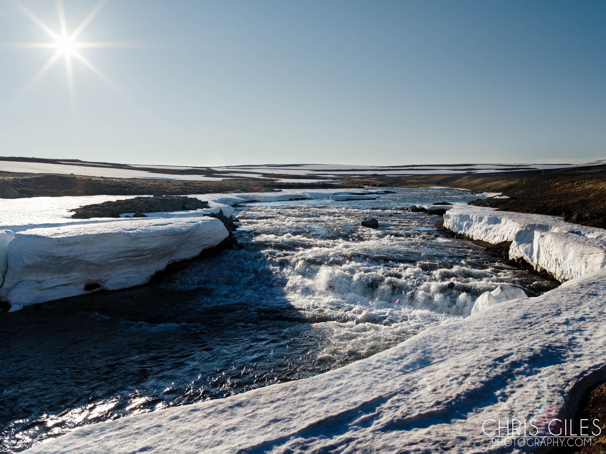 Mountain top river and glaciers of Iceland