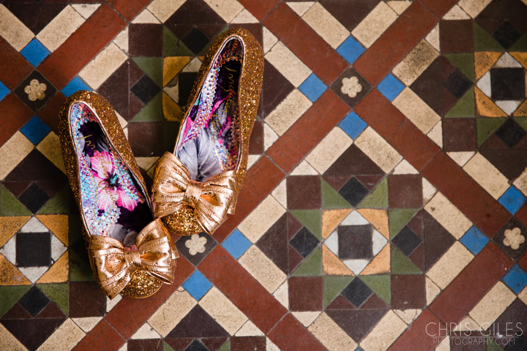 Gold sequin shooes on an old mosaic floor