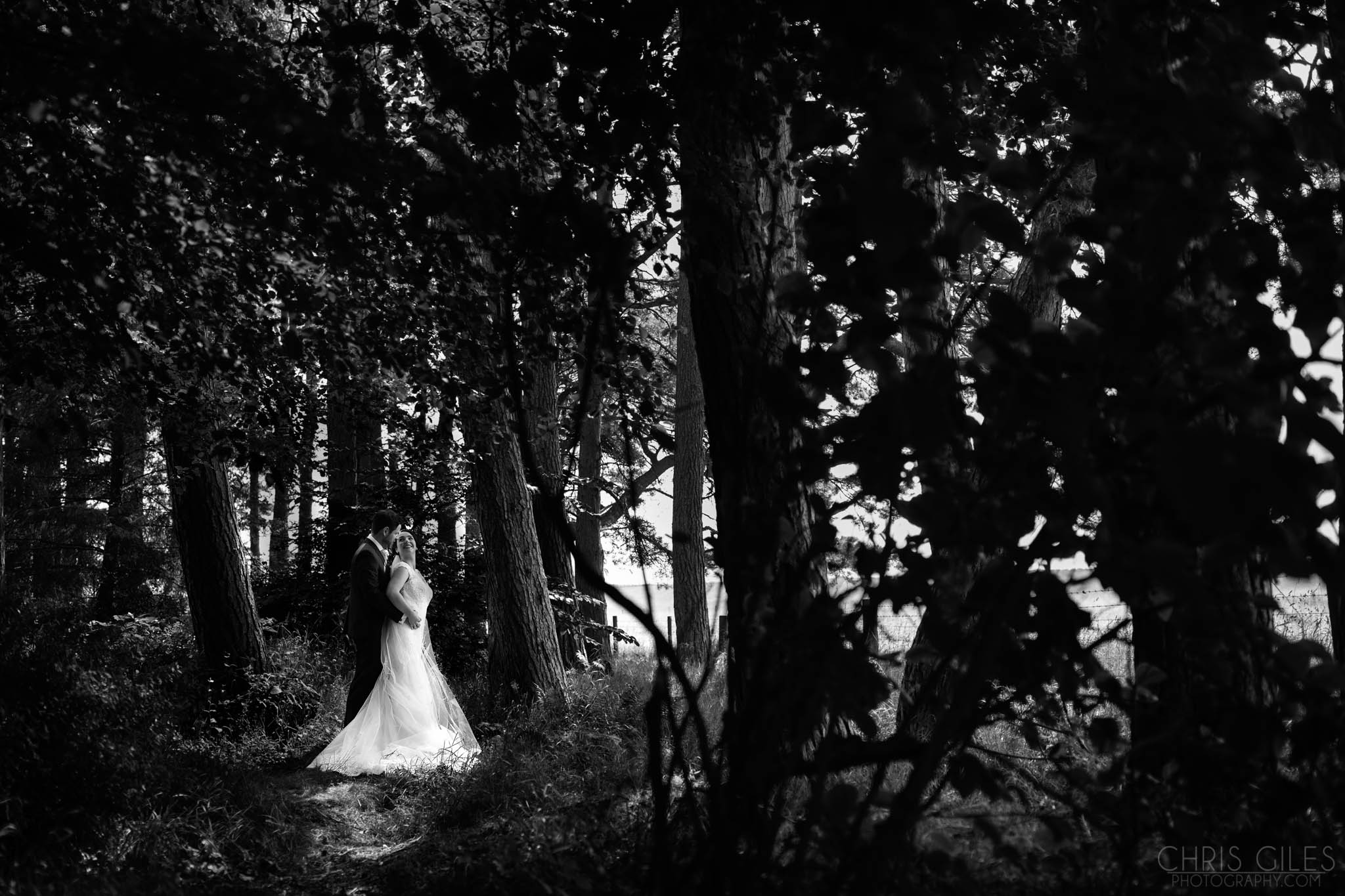 Wedding photo in the woods at Woodhill Hall